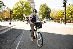 Electric Bike Rider in Madison against the Wisconsin State Capitol