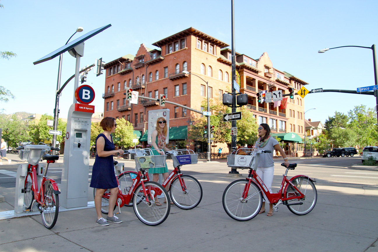 Three women check out B-cycles